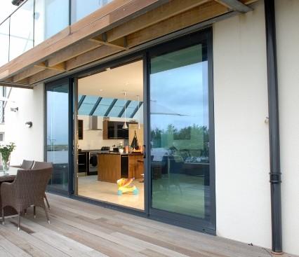 Open Patio door leading into kitchen